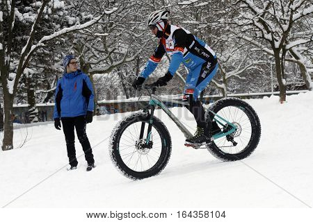 BUCHAREST ROMANIA - January 07 2017: Ice Biking on the hills covered with fresh snow in the central park in a winter day during the vacation.
