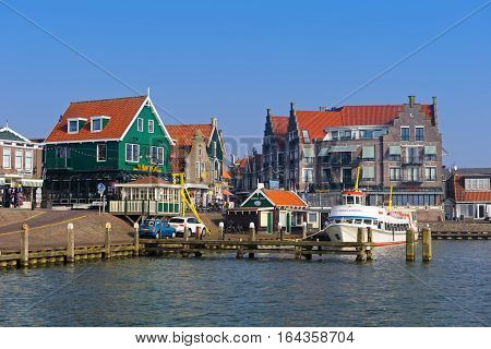 VOLENDAM, NORTH HOLLAND/ THE NETHERLANDS - February 16, 2015: View of the popular tourist destination - Volendam promenade and harbor- in winter