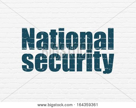 Protection concept: Painted blue text National Security on White Brick wall background