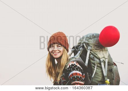 Woman Traveler happy smiling with backpack hiking Travel Lifestyle concept adventure active vacations outdoor wearing orange hat