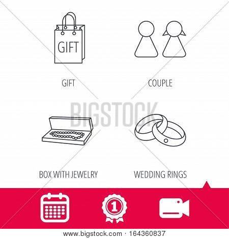 Achievement and video cam signs. Couple, gift and wedding rings icons. Box with jewelry linear sign. Calendar icon. Vector