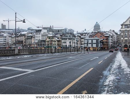 Zurich, Switzerland - 3 January, 2017: view along the Rudolf Brun bridge on an overcast day in winter. Rudolf Brun bridge is a bridge over the Limmat river, named after Rudolf Brun (1290s-1360), who the city's first independent mayor.