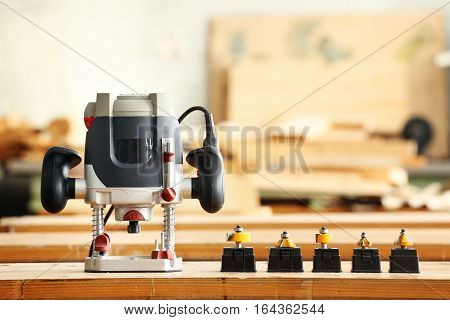 Joiner router with cutters in a carpentry