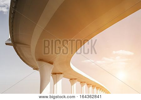 Underside of an elevated road with sun effects