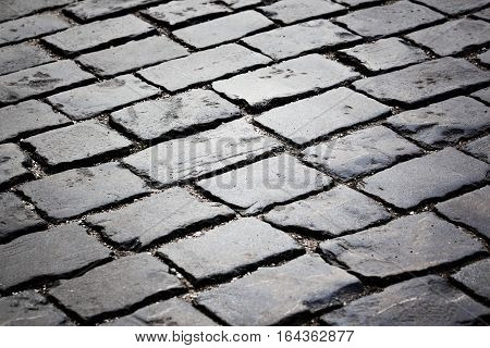 Close-up view of the paving stone street