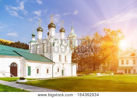 The Chernigov Martyrs church in Moscow Russia with sun rays