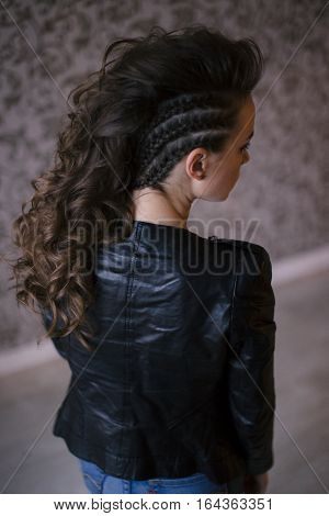 Punk rock style or halloween make-up. Fashion woman model face with bright glamour makeup. Perfect skin, black gloss eyeshadows on eyes and dark brown glossy lips visage. back view
