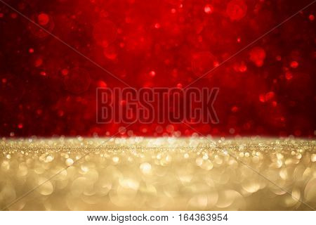 Abstract defocused gold and blue glitter valentines background with copy space