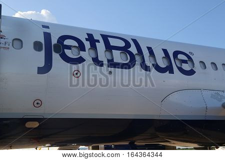 LA ROMANA, DOMINICAN REPUBLIC - JANUARY 4, 2017: Jet Blue plane on tarmac at La Romana International Airport. The Dominican Republic is the most visited destination in the Caribbean