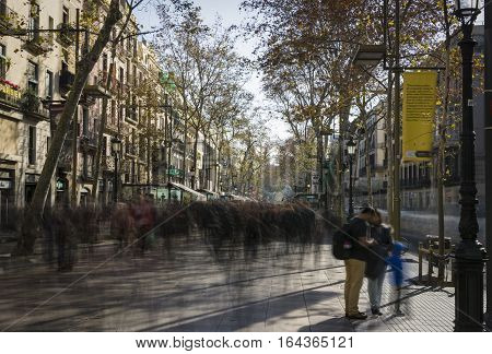 low shutterspeed shot of Famous street La Rambla in Barcelona, Spain. Thousands of people walk daily by this popular pedestrian area 1.2 kilometer long.