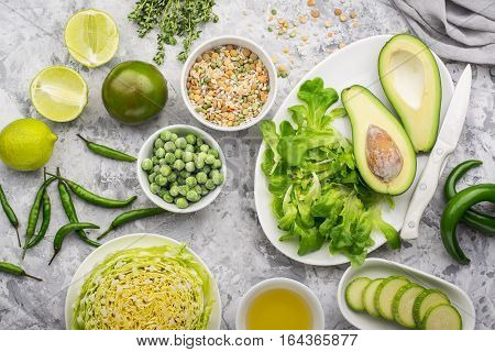 Farm green vegetables on gray marble background. Top view. Space for text. Greenery. Flat lay