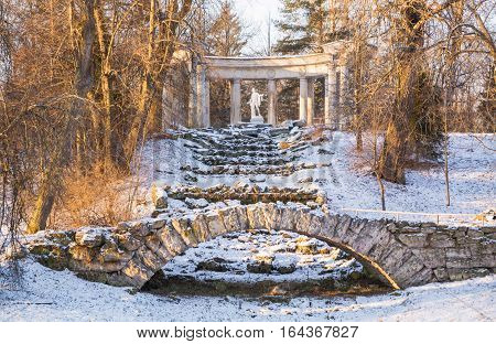 Ruins of Apollo and the stone bridge in Pavlovsk park of St.-Petersburg