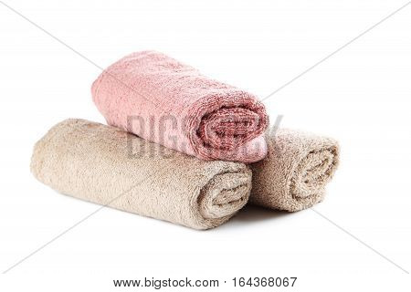 Rolled Up Towels Isolated On A White Background
