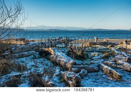 A view of the Olympic Mountains across the Puget Sound in winter.