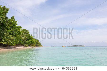Desert Zapatilla islands and boats on the archipelago Bocas del Toro, Panama