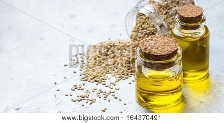Healthy food and drink concept. Sesame oil and seeds on a rustic table. Copy space background
