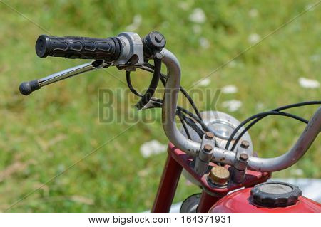 Close-up with bicycle handle. Detail of vintage bicycle handlebar with rust.