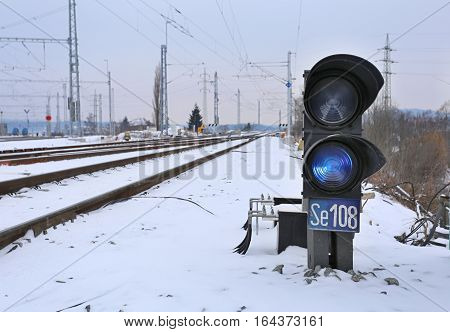 winter small railway signal in the railyard