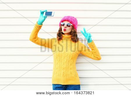 Fashion Young Woman Taking Picture Self Portrait On Smartphone Over White Background