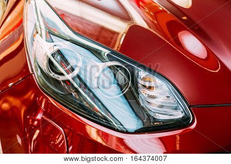 Vilnius, Lithuania - July 08, 2016: Close The Left Headlight Of New Red Kia Sportage Car, The Compact SUV In The Hall Of Acropolis Shopping Center.