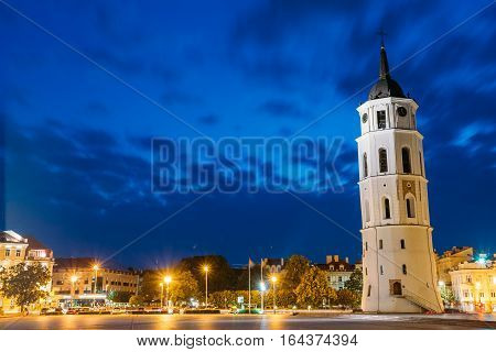 Vilnius, Lithuania. Night Or Evening View Of Bell Tower Near Cathedral At The Cathedral Square. Blue Cloudy Sky Background. Travel In Lithuania. Copyspace