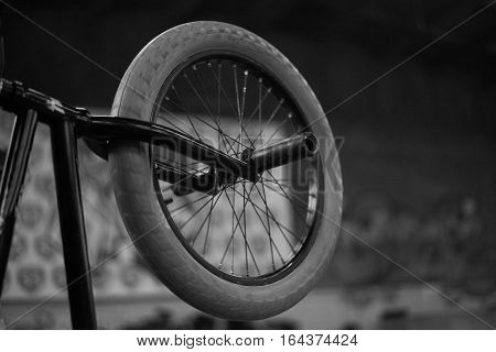 Wheel of BMX bike. Extreme sport concept with black and white colours.