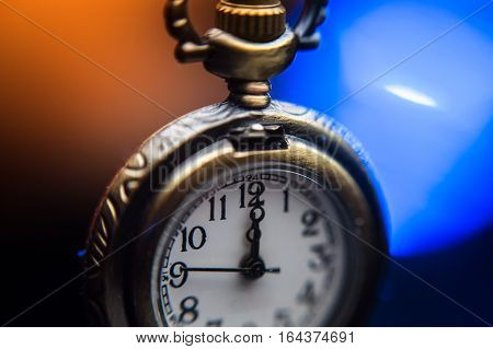 New year clock on abstract color background
