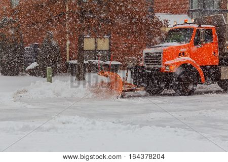 Snow clearing. Tractor clears the way after heavy snowfall. Winter snow tractor snow cleaning