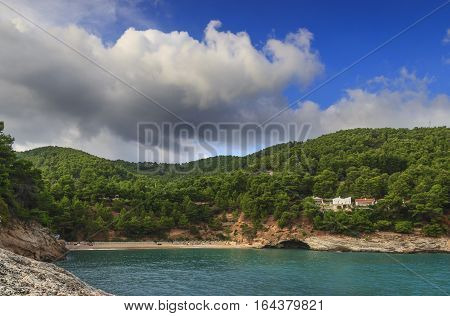 Apula coast,Gargano National Park: Pungnochiuso Bay,Porto Piatto Beach. Vieste,Italy.The bay is bounded by marvellous hills covered with age-old pine trees.