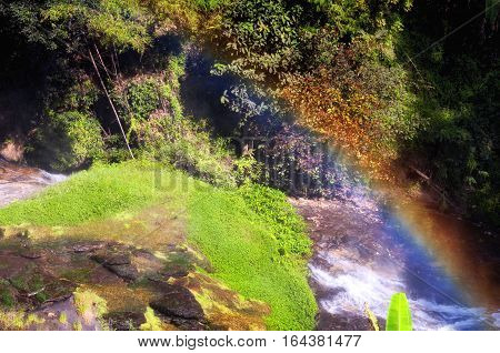 A rainbow forming in the mists from Wachirathan waterfall in Doi Inthanon National Park in Chiang Mai northern thailand.