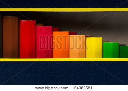 Multicolored pensils in the box. Back to school. Copy space. Top view.
