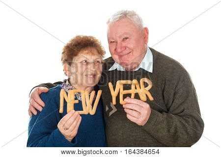 Picture of an elderly couple celebrating new year - isolated background