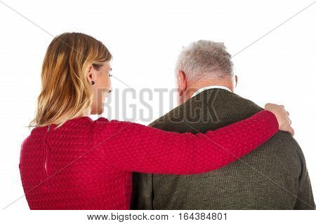 Picture of a young woman helping an elderly man - isolated background