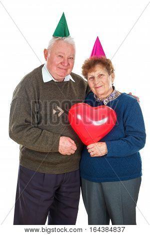 Portrait of a senior couple celebrating birthday - isolated background