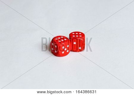 Two red isolated dice showing six pips each.