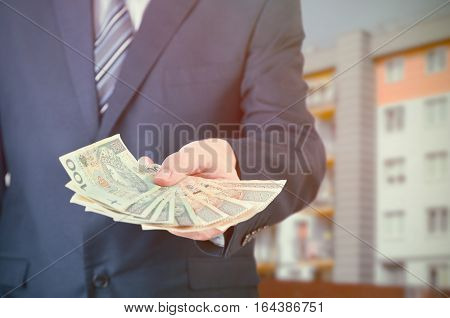 Polish Businessman Holds Money. The Loan On The House