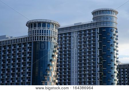 BATUMI, ADJARA ,GEORGIA - OCTOBER 212016: Modern building Apartments Sea Towershotel complex at Black Sea seaside in the center of Batumi.It is second largest city of Georgia situated in a subtropical zone near the foot of the Lesser Caucasus Mountains