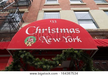 NEW YORK - APRIL 29 2016: Red canopy with christmas in new york text