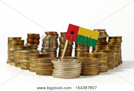 Guinea Bissau Flag Waving With Stack Of Money Coins