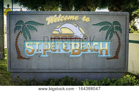 ST. PETE BEACH, USA - FEBRUARY 8, 2016: A welcome sign to St. Pete Beach Florida greets visitors as they travel along the Corey Street Causeway. With its warm climate, St. Pete Beach attracts many tourists from the north in the winter months.