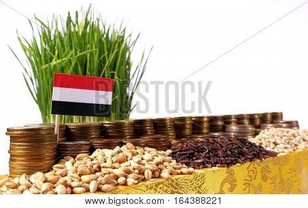 Yemen Flag Waving With Stack Of Money Coins And Piles Of Wheat And Rice Seeds