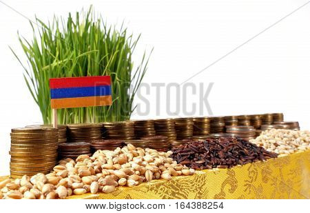 Armenia Flag Waving With Stack Of Money Coins And Piles Of Wheat And Rice Seeds