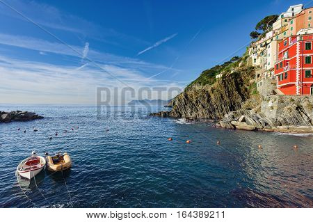 Small boats at lagoon of Riomaggiore town in Cinque Terre National park, Italy