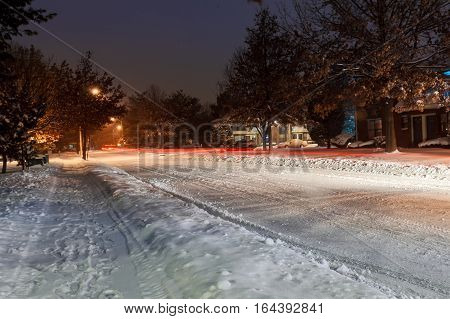 Snow on street and Highway during December 2016, icy road during winter storm, winter road in urban area at night