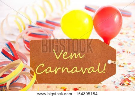 One Label With Spanish Text Vem Carneval Means Happy Carnival. Party Decoration Like Streamer, Confetti And Balloons. Wooden Background With Vintage, Retro Or Rustic Syle
