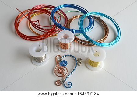 Craft wire with bass clef and treble clef symbols on white background