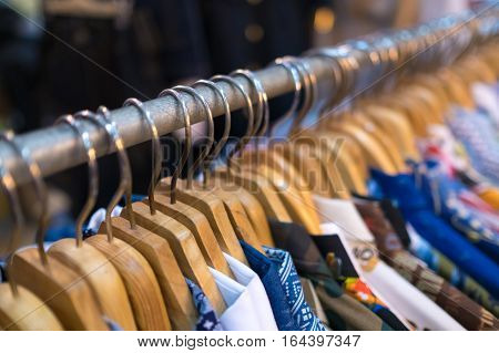 Clothes on clothes rail in clothing store. selective focus
