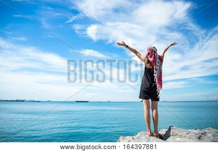 Traveler young women seeing the beautiful beach and blue sky so happy and relax