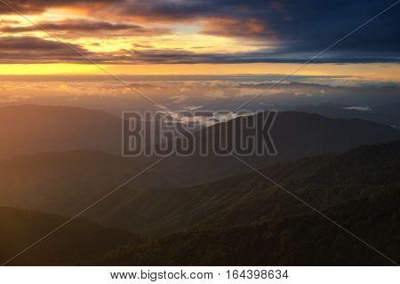 Sunrise twilight sky with sea of clouds view on Doi Phu Kha, Nan province, Thailand.