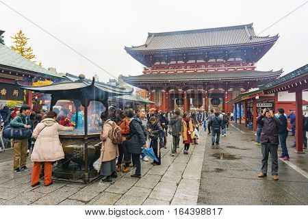 Tokyo Japan - November 19 2016 : The Senso-ji Temple and giant incense burner . Asakusa is the most famous temple in Tokyo Japan.